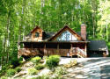 Maggie cabin in the woods by a mountain stream
